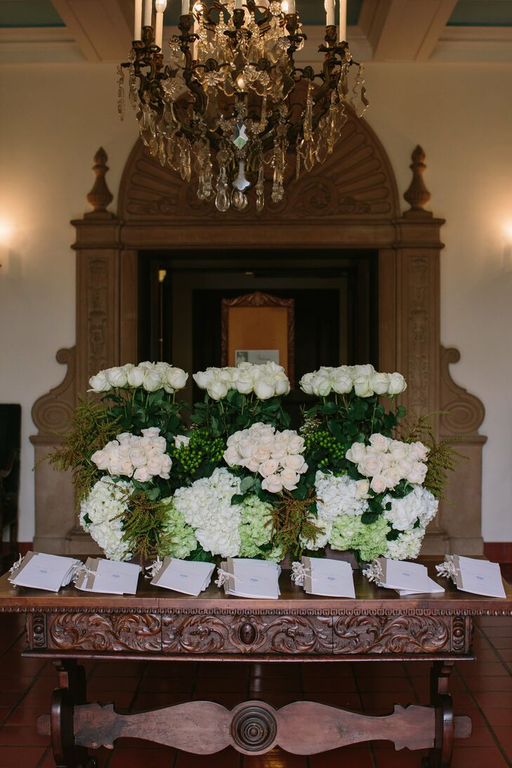 The ceremony programs were designed to echo the romantic theme of the wedding and were displayed with lush floral arrangements for guests to have something to look while waiting for the ceremony to begin.
