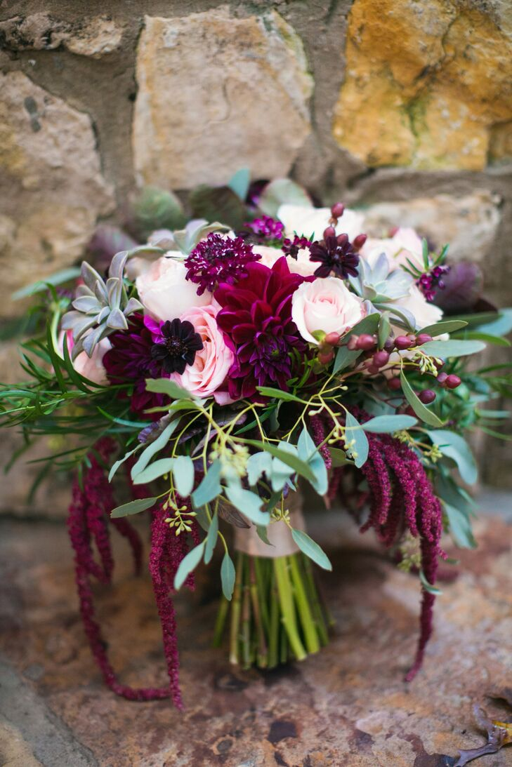 Candace's bridal bouquet consisted of pink garden roses, seeded eucalyptus, hanging amaranthus, burgundy garden roses, wine scabiosa, succulents, kale and wine-colored berries and dahlias, hand tied with twine.