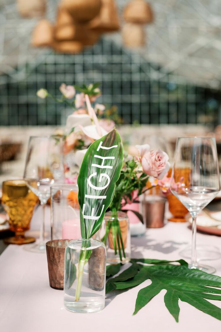 Tropical leaf table number as part of boho tablescape