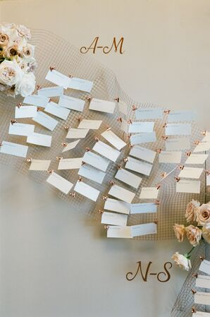 Eclectic, Romantic Paper Escort Card Display with Netting and Flowers