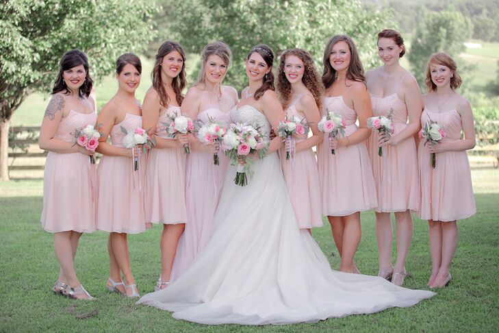 The bridesmaids wore short strapless blush dresses with bouquets of pink and white blooms. Silver strappy shoes completed their looks.