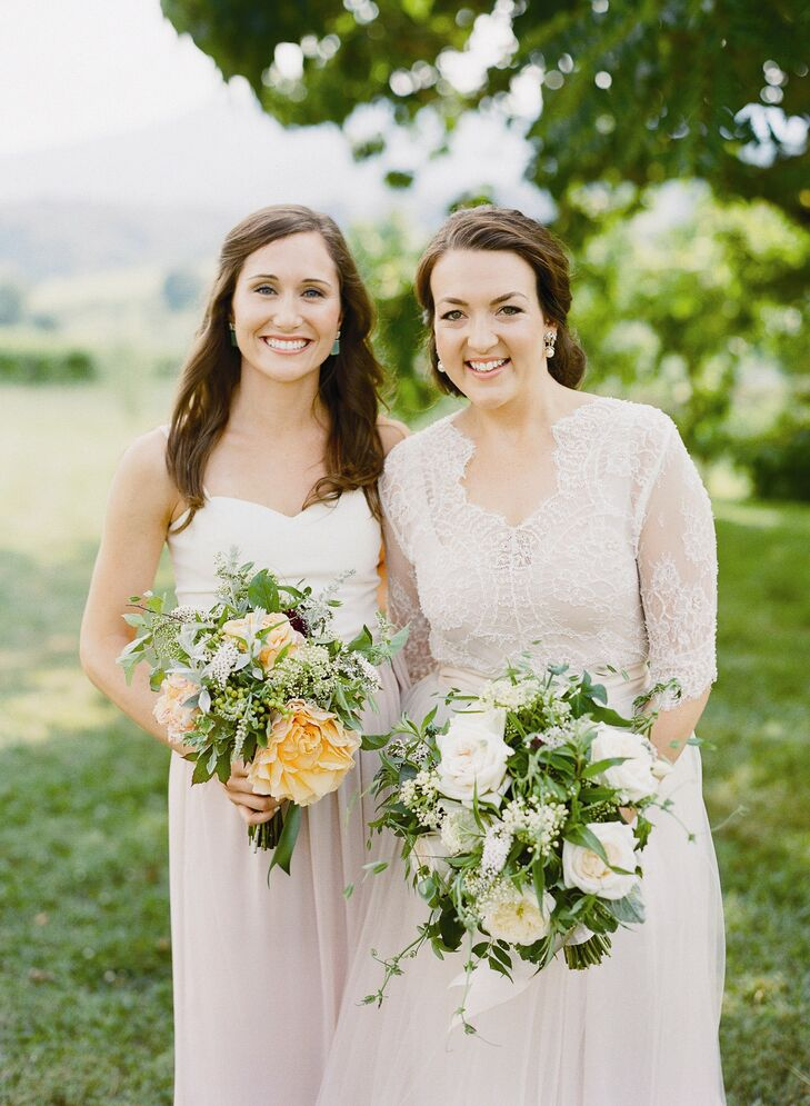 Augusta carried an unfussy bunch of garden roses, dahlias, white sumac, herbs, scabiosa, green viburnum berries and passion flower vine. The bridesmaids carried similar bouquets with a touch of color.
