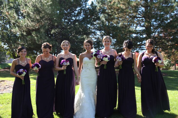 The bridesmaids donned long chiffon gowns by Bill Levkoff in a dark shade of eggplant. Each girl was able to choose her own dress style to best suit her personal style and shape.