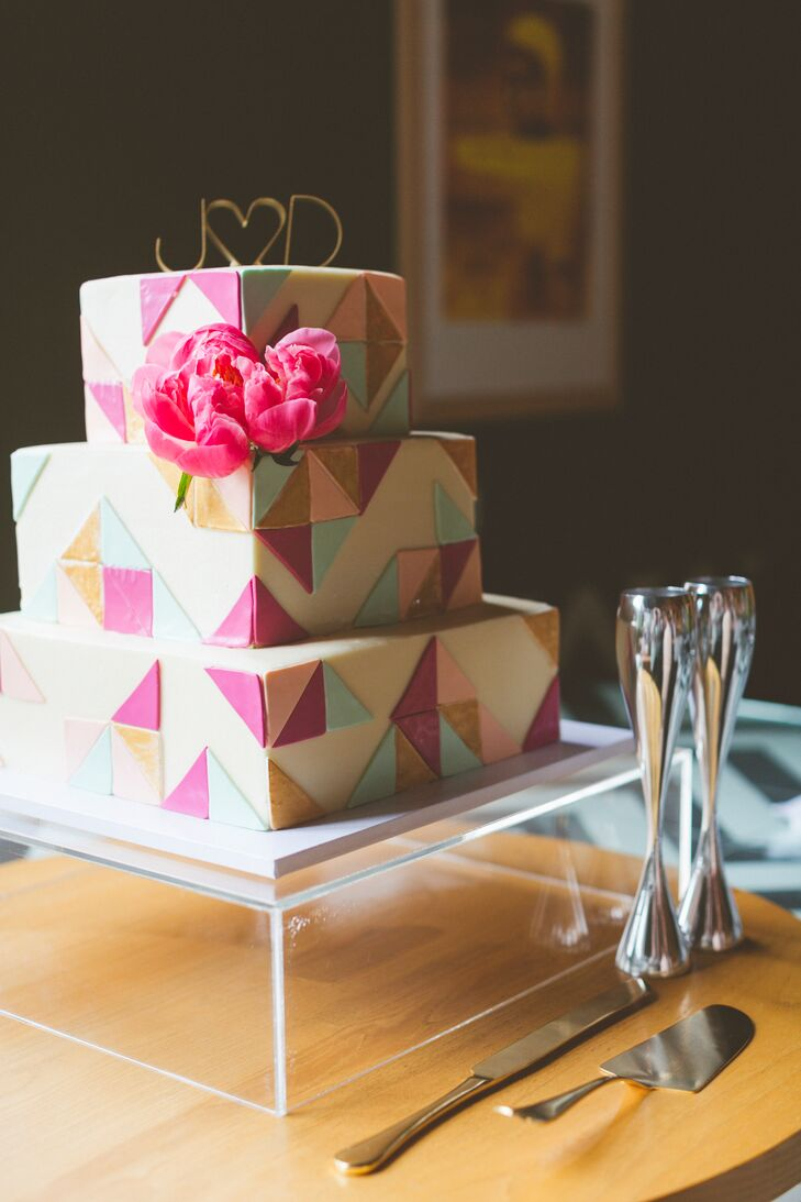 The wedding cake by Baked by Amy's embodied the wedding's colorful, geometric theme. It had vanilla buttercream with hand-painted fondant triangles in pink, mint and metallic gold, with a fresh pink peony on the second tier. The Mexican vanilla cake with two fruit fillings was delicious.