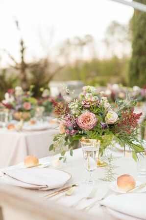 Ivory Linens and Romantic Centerpieces of Roses and Wildflowers