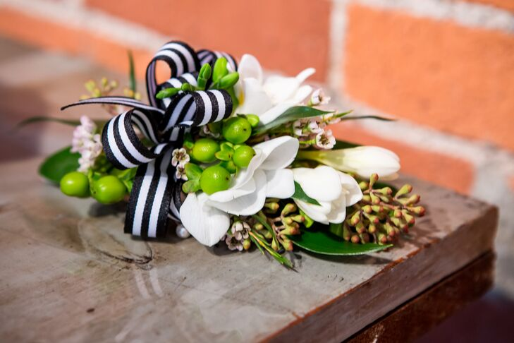 White Lily and Green Hypericum Boutonniere