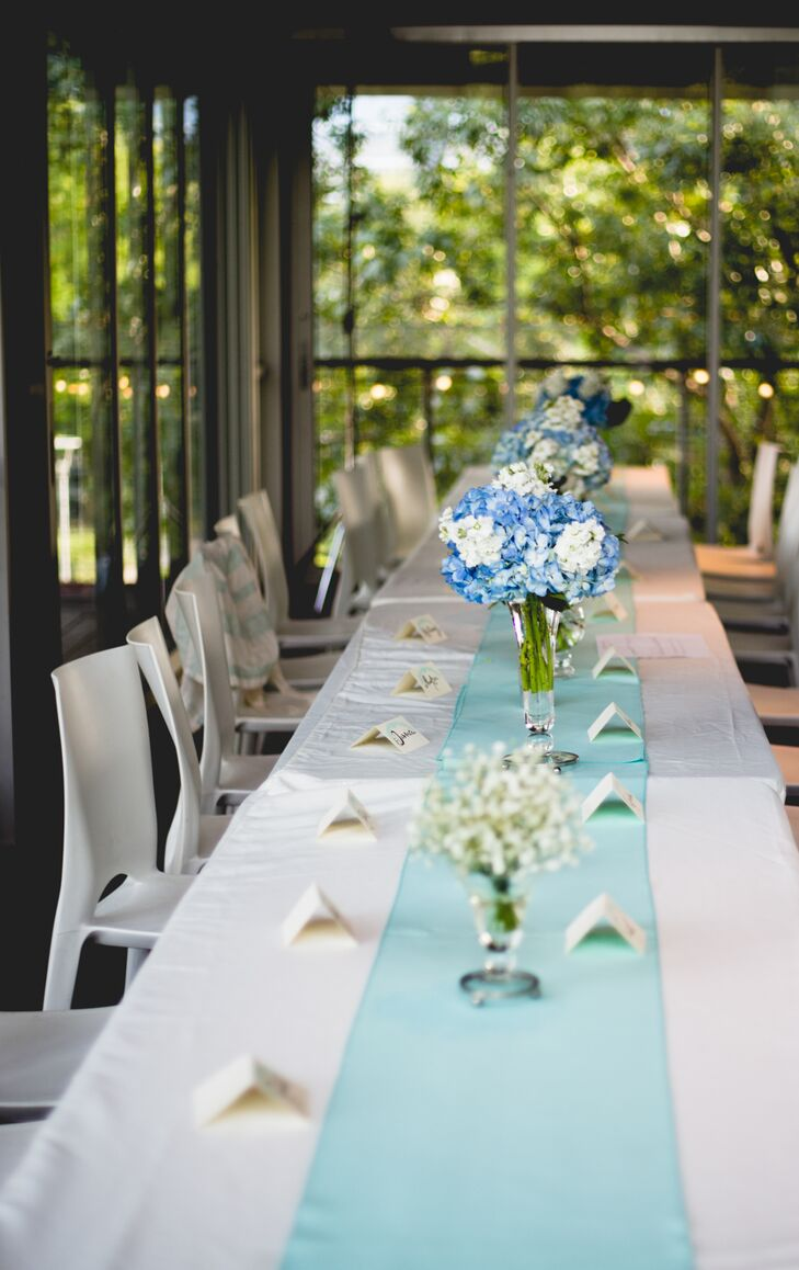 The head table had blue hydrangea flower arrangements with scattered baby's breath and succulents.