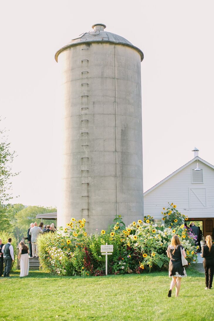 After being pronounced husband and wife, the newlyweds and their guests headed to Candlelight Farms's historic barn for cocktails, appetizers and lots of fun. Guests tried their hands at an assortment of lawn games while they whet their whistles and snacked on bite-size eats like tomato soup shooters and mini-grilled cheese.