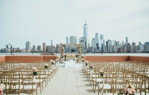 Elegant Riverfront Ceremony with Manhattan Skyline Backdrop