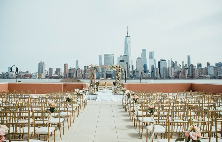 Elegant Riverfront Ceremony with Manhattan Skyline Backdrop