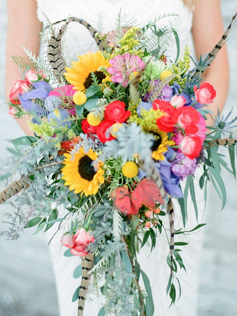A bridal bouquet with sunflowers and feathers