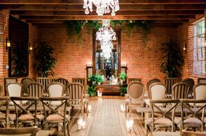 Intimate Ceremony Site with Brick, Chandelier and Mismatched Chairs