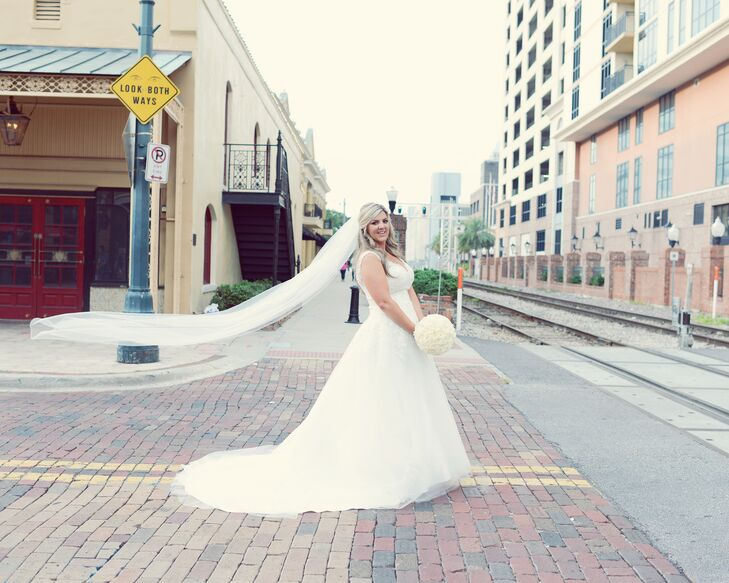 Amanda wore an elegant white ballgown with a cathedral-length veil.