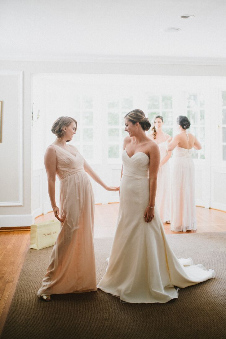 Beth wore an ivory, strapless Jim Hjelm gown with a lace and organza ruched sweetheart neckline bodice and an organza modifed A-line skirt with a chapel-length train and a jeweled belt.