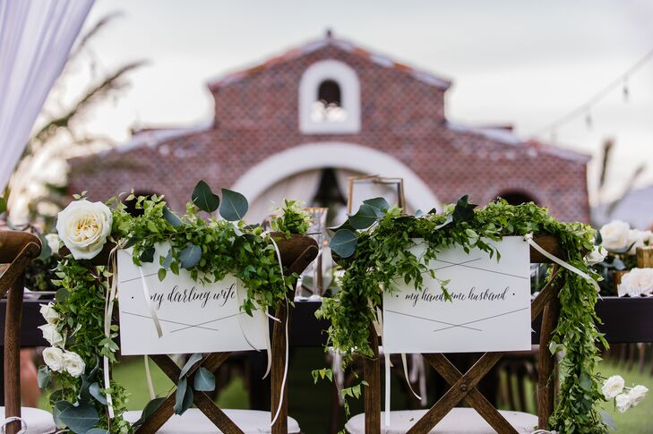 The bride and the groom's table was accented with charming seating signage for both.