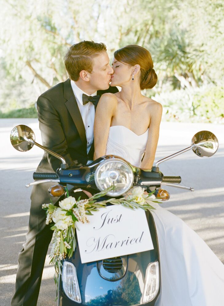 On her 24th birthday, Jillian received a midnight blue Vespa from Jason as a gift. They felt it was only appropriate to make their grand exit via the speedy scooter, which they decorated with fresh florals and a Just Married sign.