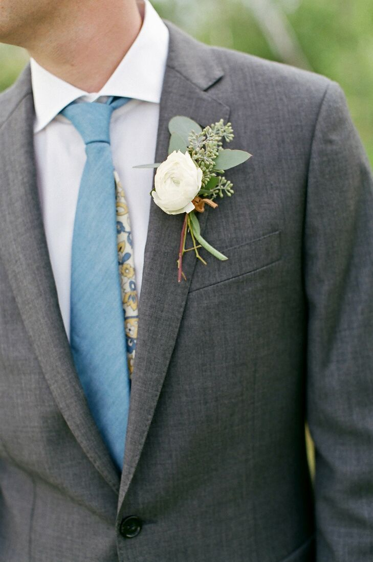 Alex created custom ties for himself and his groomsmen. He chose a slate blue front with a 1940s-inspired yellow and blue floral print on the back.