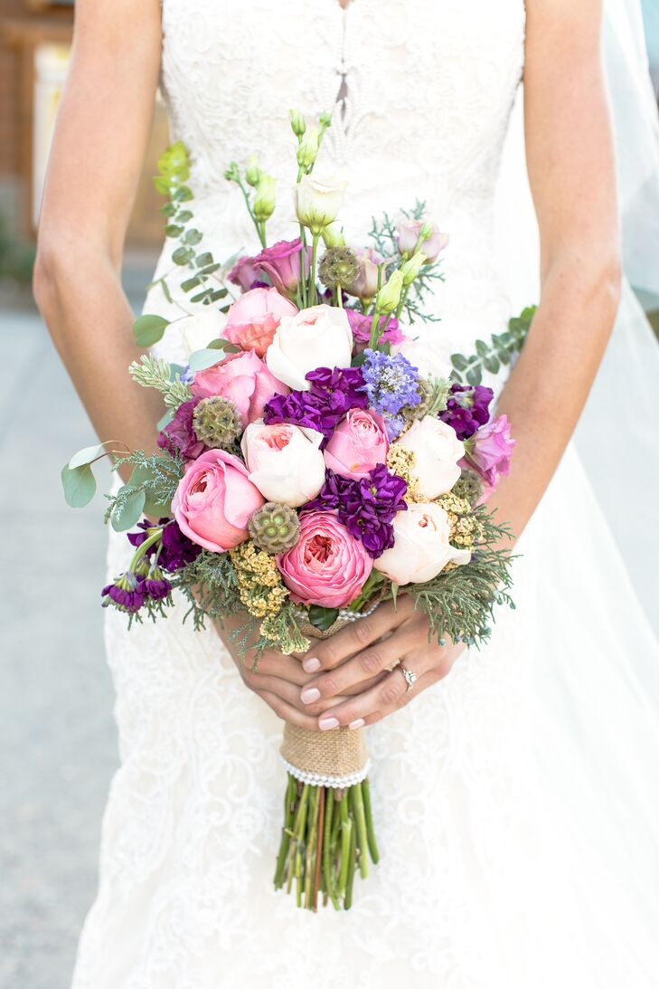 """Abigail entrusted her sister with crafting the flower arrangements in a palette of pink, purple and ivory. """"Since the climate is so dry in Bend, some vegetation and flowers do better than others, and my sister understood that more than I, so I just gave her some guidelines for colors and let her creative juices flow. I knew I was in good hands."""""""