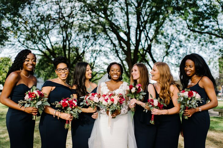 Classic Bride and Modern Bridesmaids Wearing Black Gowns