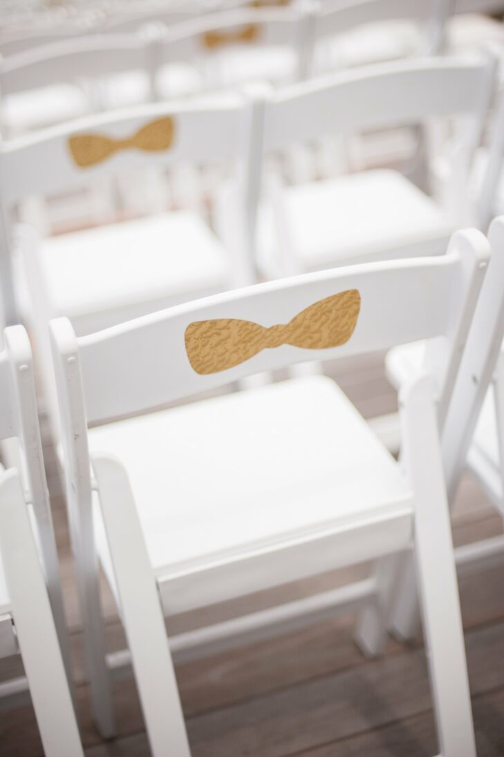 Some of the chairs were decorated with a modern gold bow sticker to bring a little fun to the chairs and complement the gold glitter aisle liner.
