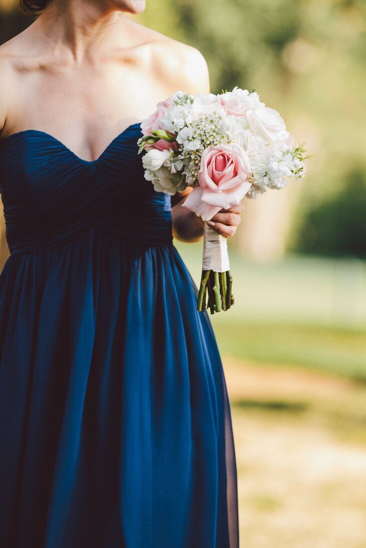 The bridesmaid bouquets complemented Heather's bridal bouquet and had pink and white roses, wax flowers, stock flowers and hydrangeas.