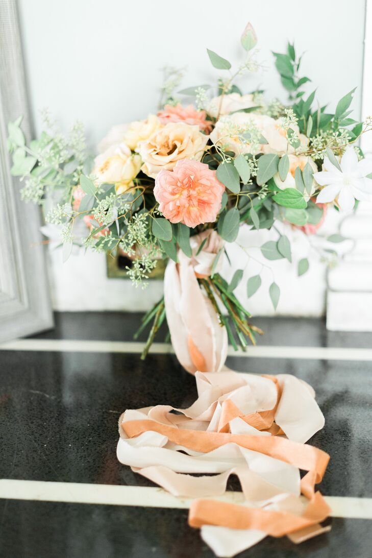 The bridal bouquet featured peach blooms (Bonnie's favorite color) mixed with lush greenery and wrapped in tonal ribbon.