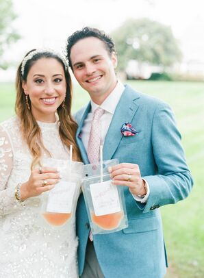 Couple Holding Cocktail Drink Pouches During Backyard Microwedding
