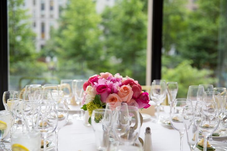 An arrangement of pink roses decorated the crisp white tables at the reception.