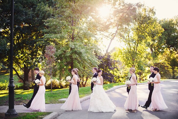 The bridesmaids wore blush Monique Lhuillier floor-length dresses while the groomsmen wore classic black tuxedos with bow ties.