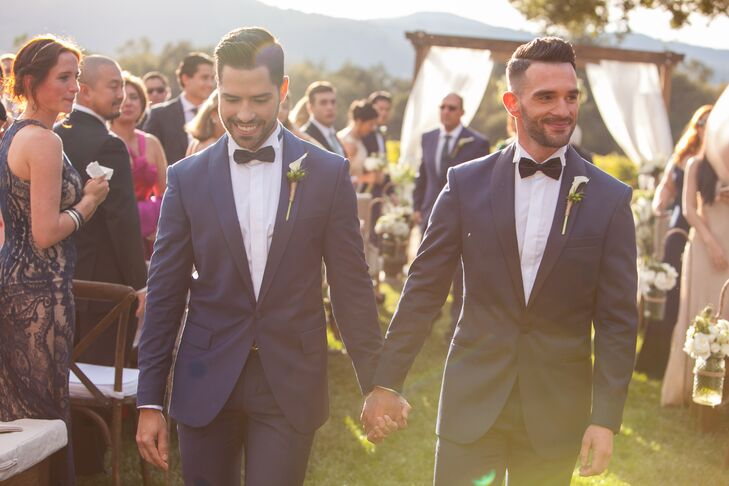 """""""Being a gay couple makes the choice of attire difficult,"""" Renato says. """"We wanted to match but not be the same. We wanted it to be a modern tuxedo, and we wanted it to go well with the palette we chose."""" Renato and Patrick chose Ermenegildo Zegna tuxedos in contrasting (but complementary) blue hues."""