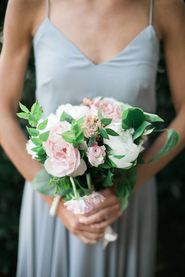 Rye Workshop took the lead on all the wedding's flowers, creating loosely tied arrangements of full garden roses, peonies, ranunculus, greenery and astilbes for Alexandra's 10 bridesmaids to carry down the aisle.