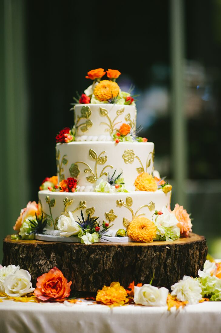 This incredible wedding cake by Cakes by Cynthia felt like fall: gold details over ivory buttercream and pops of flowers in earth tones. It was a carrot cake, which is Pamela's favorite.