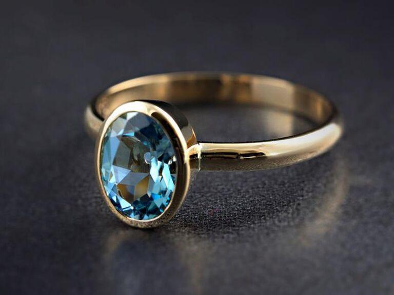 aquamarine gemstone ring with gold band