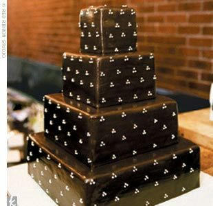 The four-tier square cake was vanilla with vanilla buttercream filling and dark chocolate fondant frosting with a white Swiss dot motif.