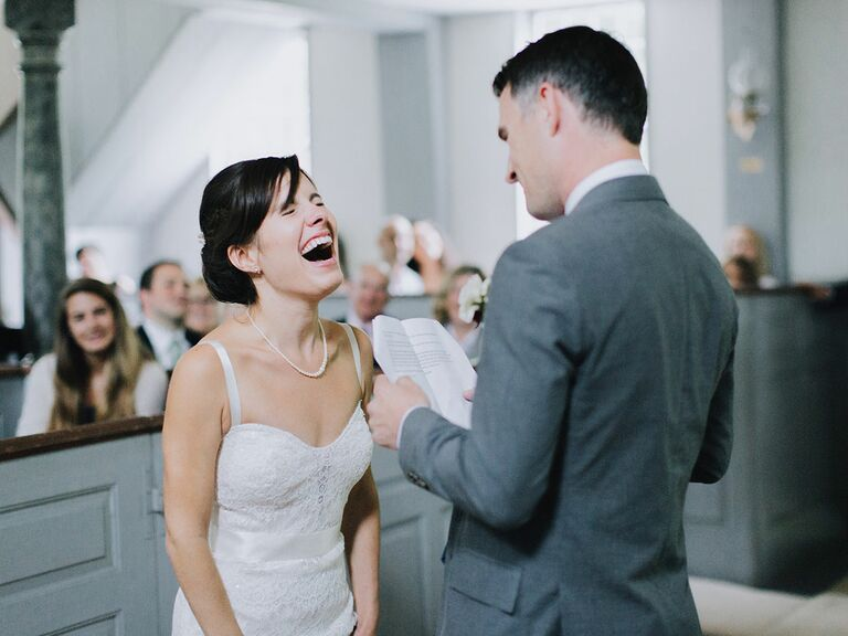 bride and groom laughing during wedding ceremony vows