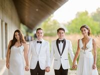 Grooms and bridesmaids wearing white on wedding day
