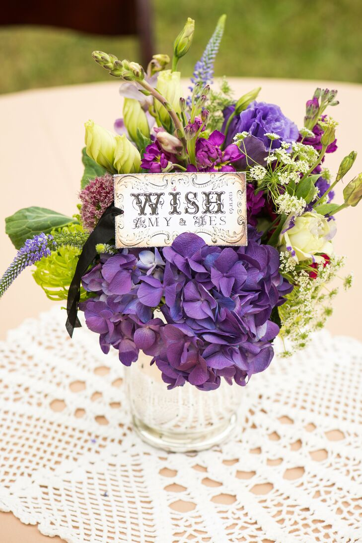 Amy and Jes's centerpieces included blooms of purple hydrangea and the couple's Wish motif.