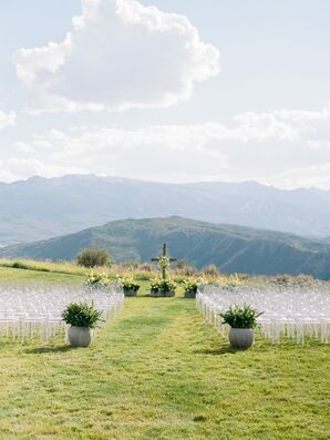 Modern Mountain Ceremony with Ghost Chairs and Potted Greenery