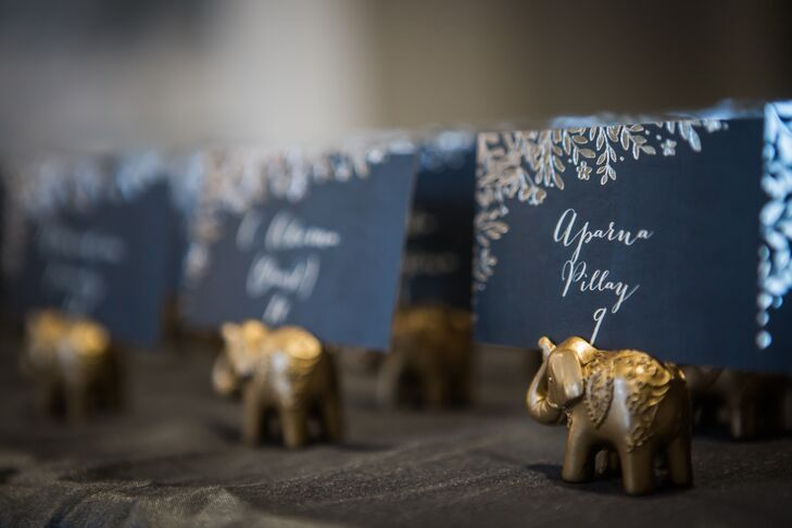 For a touch of Indian tradition, guest place cards were held by bronze elephants, which symbolize wisdom.