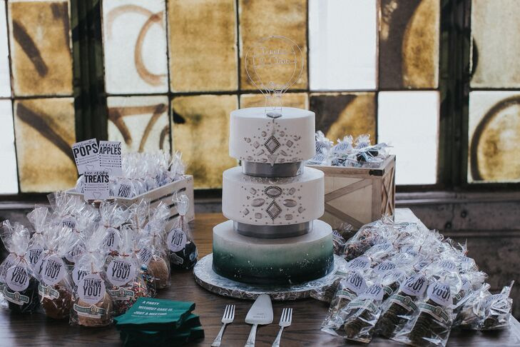 """The Cake Boutique in Albuquerque, New Mexico, created the couple's three-tier, emerald-hued bejeweled cake. Their wedding favors also had a local touch—marshmallow and chocolate candies from Chocolate Dude. """"It was a big deal for us to feature local vendors and shops throughout our wedding weekend for all our out-of-town guests,"""" Teresa says."""