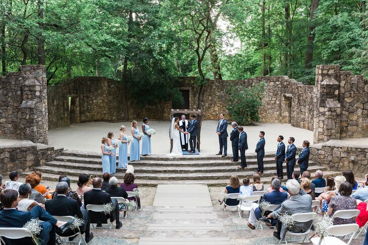 Chelsea and Clay exchanged vows on the University of North Carolina campus at the Forest Theatre. They loved the natural setting and used it as inspiration for their blue, ivory, green and brown color palette.