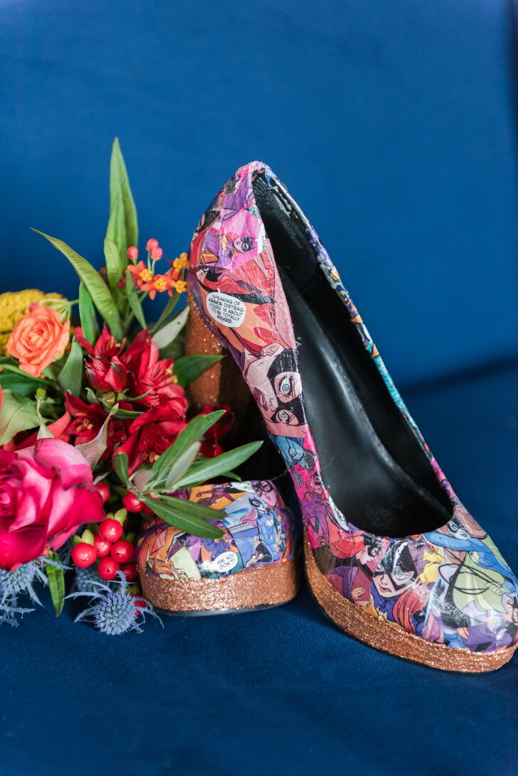 "Sally made her unique shoes with Mod Podge, glitter and Bat Girl comics. ""With my dress being so traditional, I thought I'd have a little piece of my nerdiness shine through with my shoes,"" she says. (She practiced walking in them for weeks to avoid tripping down the aisle.)"