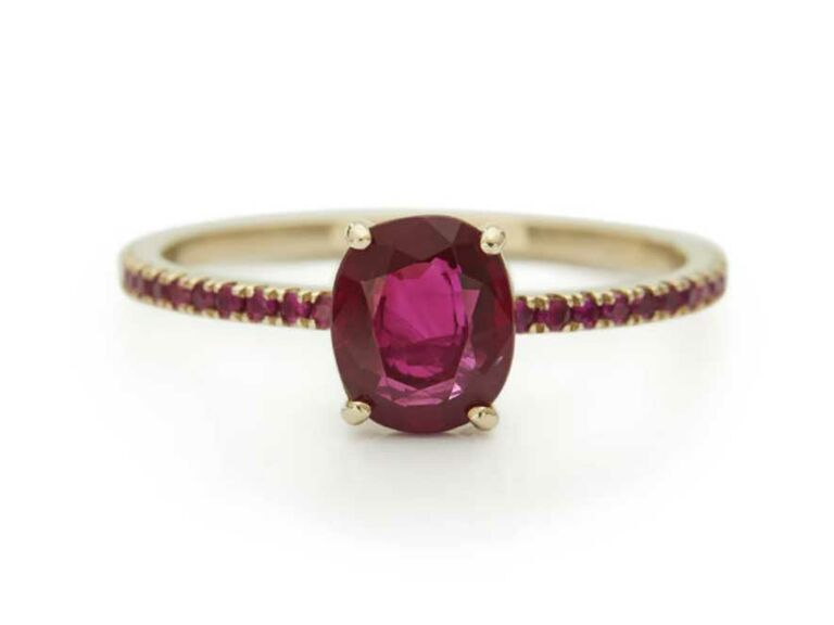 Oval ruby engagement ring with pavé ruby-encrusted band