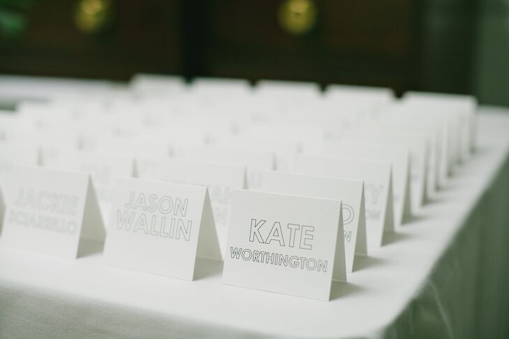 Printed materials—including these place cards—were in various modern typefaces and justified in a square or rectangle.