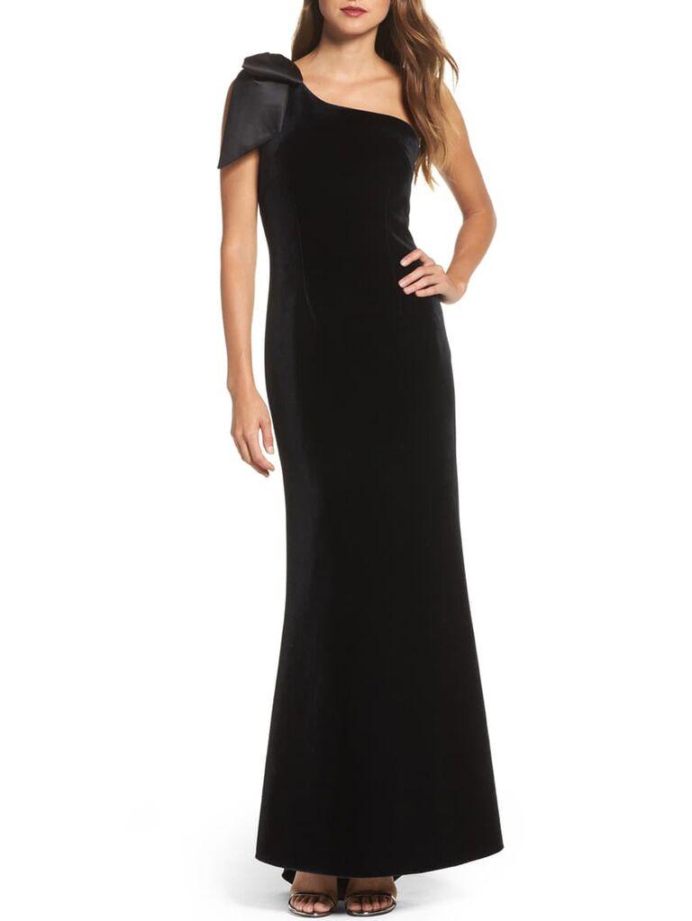Black velvet one-shoulder evening gown with bow on shoulder