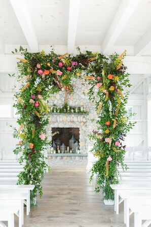 Whimsical Greenery Wedding Arch with Colorful Flowers