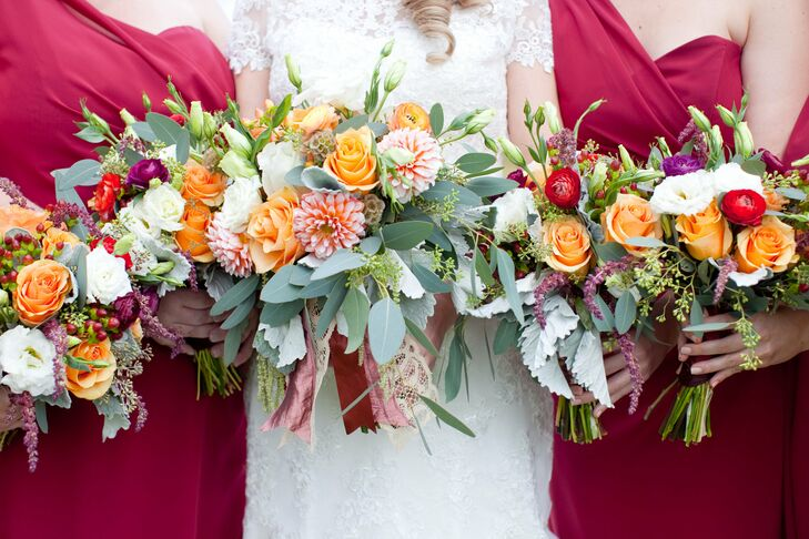 The bouquets at this fall wedding included dahlias, roses, ranunculus, scabiosa pods, dusty miller and eucalyptus.