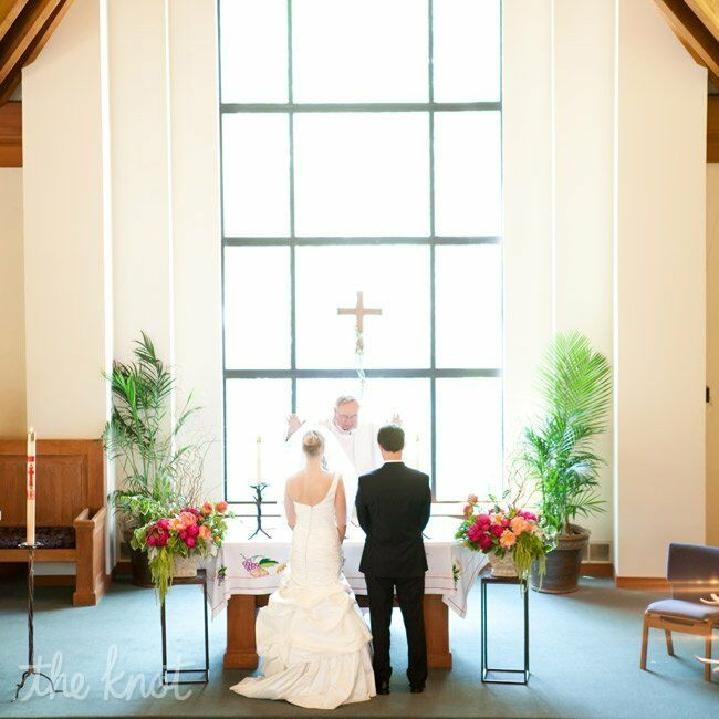 The church's floor-to-ceiling windows flooded the altar with natural light at Kate and Phil exchanged vows.