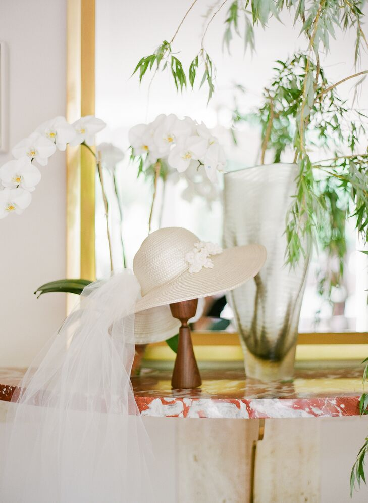 Sarah's mother's 1970s wedding outfit and the contemporary architecture of her childhood home inspired the bohemian-meets-Bauhaus wedding aesthetic. Sarah even wore a veiled, broad-brim hat instead of a veil, echoing the one her mother wore decades earlier.
