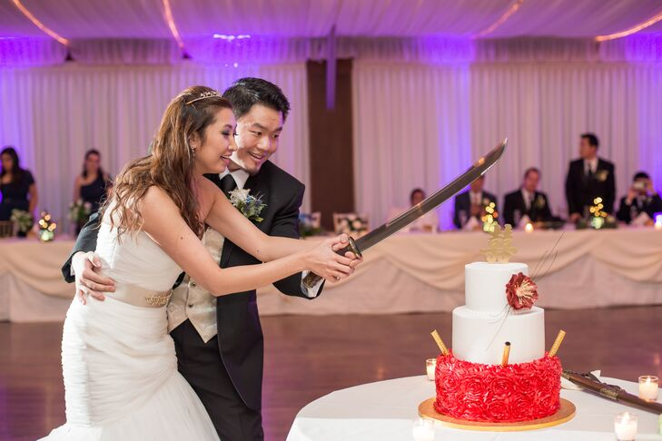 The wedding cake (inspired by a design Nicole Found on Pinterest) was topped with the Chinese symbol for double happiness. For the cake cutting, Nicole and Liyan used a Dao (a traditional Chinese sword) instead of a knife.